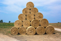 Golden straw bales. Arranged in a triangular stack bales of harvested grain Stock Image