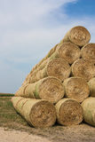 Golden straw bales. Arranged in a triangular stack bales of harvested grain Royalty Free Stock Photos