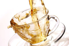 Golden Stream Of Tea Royalty Free Stock Photos