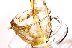 Golden stream of tea Royalty Free Stock Photos