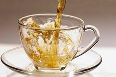 Golden stream of tea 3 Royalty Free Stock Photos