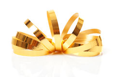 Golden streamer. Over white background Stock Photo