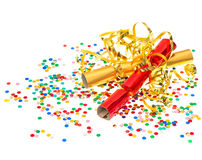 Golden streamer, party cracker and confetti over white backgroun. Golden streamer, party cracker and multicolor confetti over white background. festive Royalty Free Stock Image