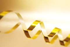 Golden Streamer on shiny background. Holiday background or greet Stock Images