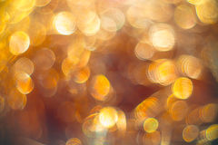 Golden streamers with sparkling glitter - Christmas holidays background Royalty Free Stock Images