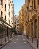 The golden streets of downtown Beirut (Lebanon). The native traditional yellow limestone gives a golden glow as the sun strikes the classic style architectural Royalty Free Stock Photos