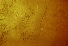 Golden stucco background Stock Image