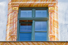 Golden stucco on the outside wall of a window Stock Photo