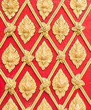 Golden stucco pattern in the traditional Thail style. Stock Image