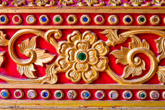 Golden stucco Thai art style in temple Royalty Free Stock Photography