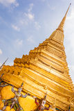 Golden Stupa and demon Stock Photos