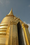 Golden stupa gate and blue sky in Bangkok Thailand Royalty Free Stock Photos