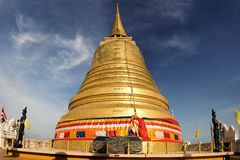 Golden stupa religious icon in Bangkok of Thailand Stock Images