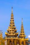 Golden stupa of Shwedagon Pagoda at twilight. Royalty Free Stock Images
