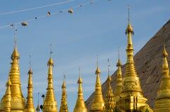 Golden stupa of Shwedagon Pagoda at twilight. Stock Photos