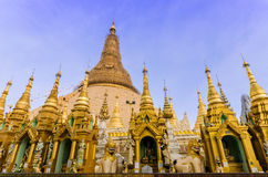 Golden stupa of Shwedagon Pagoda at twilight. Royalty Free Stock Photos