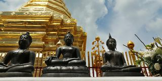 Stupa. Golden stupa and statue of buddha in buddhist temple Stock Images