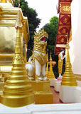 Golden stupa and statue in a Buddhist Temple Royalty Free Stock Image