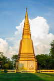 Golden Stupa In Thailand. Golden Stupa And The Clouds Stock Photo