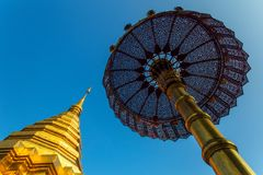 Golden stupa and umbrella in buddhist temple in Chiang Mai, Thai Stock Images