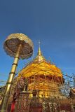 Golden stupa and umbrella structure Stock Photos
