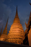 Golden Stupas in Bangkok. Golden Stupas at night, near the royal palace in Bangkok royalty free stock photography