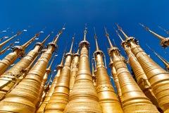 Golden stupas of Shwe Indein Pagoda. Myanmar (Burma). Golden stupas of Shwe Indein Pagoda over blue sky. Indein village, Inle Lake, Shan State, Myanmar (Burma Stock Image