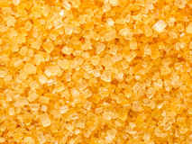 Golden sugar crystals Stock Photography