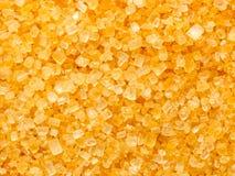 Golden sugar crystals Stock Photography