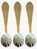 Golden Sugar Spoons Stock Photos