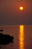 Golden sun. Sunset in Milos stock photos