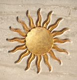 Golden sun button. Golden sun carved in lime stone Royalty Free Stock Photo