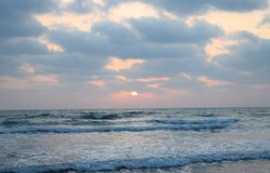 Golden Sun among Clouds over Infinite Ocean - Natural Sunset Wallpaper Royalty Free Stock Photography