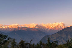 Golden sun rays falling on snow cladded peaks of Gangotri group of Garhwal Himalayas during sunset from Deoria Tal. Kedarnath peak demaracte the northern Stock Photo