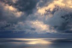 golden sun rays on sea Stock Image