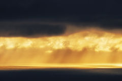 Golden sun rays on the sea at sunset Royalty Free Stock Image