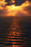 Golden sun rays on the sea at sunset Royalty Free Stock Images