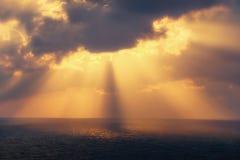 Golden sun rays on the sea at sunset Stock Photo
