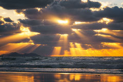 Golden sun rays on the sea at sunset Stock Image