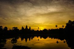 Golden Sunrise over Angkor Wat Temple, Cambodia, reflected in the Flood Water Benetah. Golden Sun rising over the Angkor Wat Temple Cambodia, which is stock images