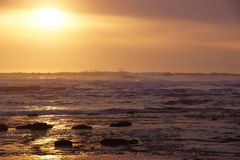 Golden sun setting on the Pacific Ocean Stock Image
