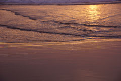 Golden sun setting on the Pacific Ocean Royalty Free Stock Photography