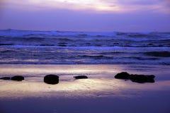 Golden sun setting on the Pacific Ocean Stock Photos