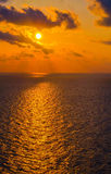 Golden Sun and Skies Over the Gulf. Waters royalty free stock images