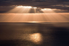 Golden Sunbeams. Appear on the sea in the early morning Stock Photo