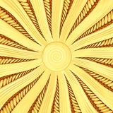 Golden sunburst background with rays and beams Stock Image