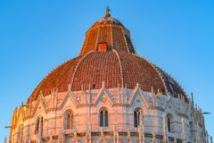 Golden sunlight hit on the dome of Pisa Baptistery in Italy at s Royalty Free Stock Image