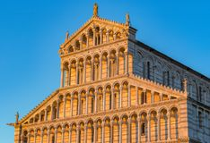 Golden sunlight hit on the facade of Pisa Cathedral in Italy at Royalty Free Stock Photo