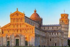 Golden sunlight hit on the top of the Leaning Tower and Pisa Cat Royalty Free Stock Photography