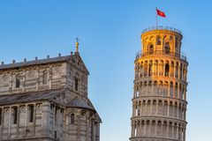 Golden sunlight hit on the top of the Leaning Tower and Pisa Cat Royalty Free Stock Photos
